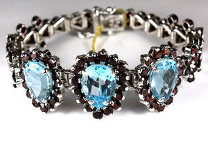 Sterling Silver Garnet and Blue Topaz Floral Bracelet