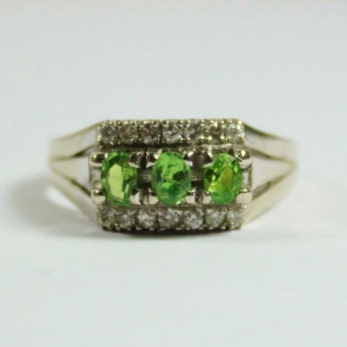 18ct White Gold Peridot and Diamond Bridge Ring