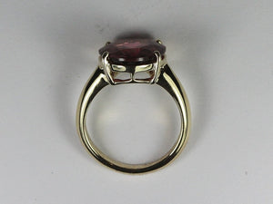 9ct yellow gold single clawset oval burgundy rubellite tourmaline ring