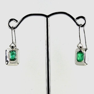 9ct white gold 0.5 carat baguette claw set colombian emerald earrings