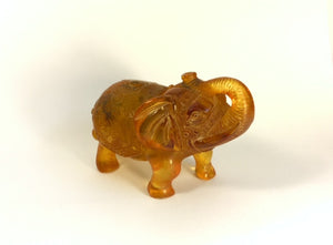 One Hand-Carved Amber Elephant