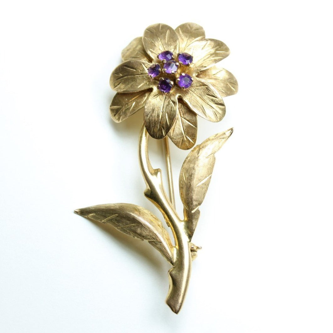 Carved Gold and Amethyst Flower Brooch