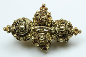 Gold Brooch featuring Cannetille work
