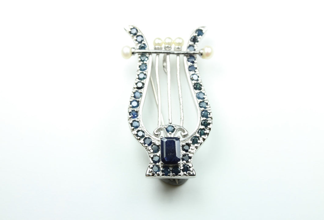 Lyre Shaped Brooch set with Natural Baguette Sapphire