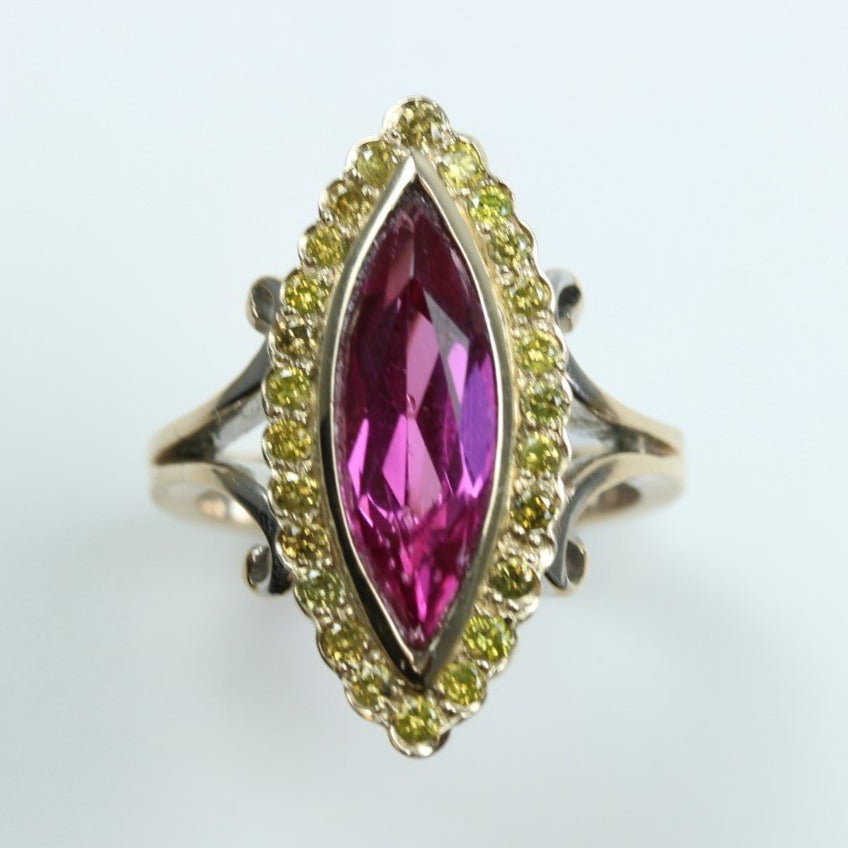 9ct Yellow Gold Marquise Cut 3.84ct Synthetic Pink Sapphire Centering Brilliant Cut Yellow Diamond Cocktail Ring