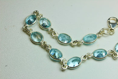 Oval Blue Topaz and Sterling Silver Bracelet