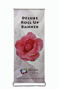 front facing view of deluxe roll up banner with flower graphic