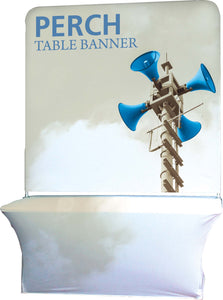 table draped in white table cover with a table banner behind it