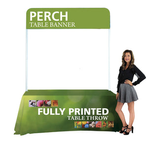 woman posing next to table draped in custom printed table cover and a banner on top