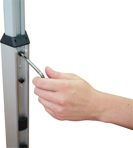 person holding hex screw tightening the telescopic pole to adjust height