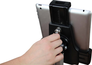 person holding hex screw tightening back of tablet holder with tablet in place