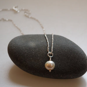 Simple Pearl on a Shimmering Silver Chain