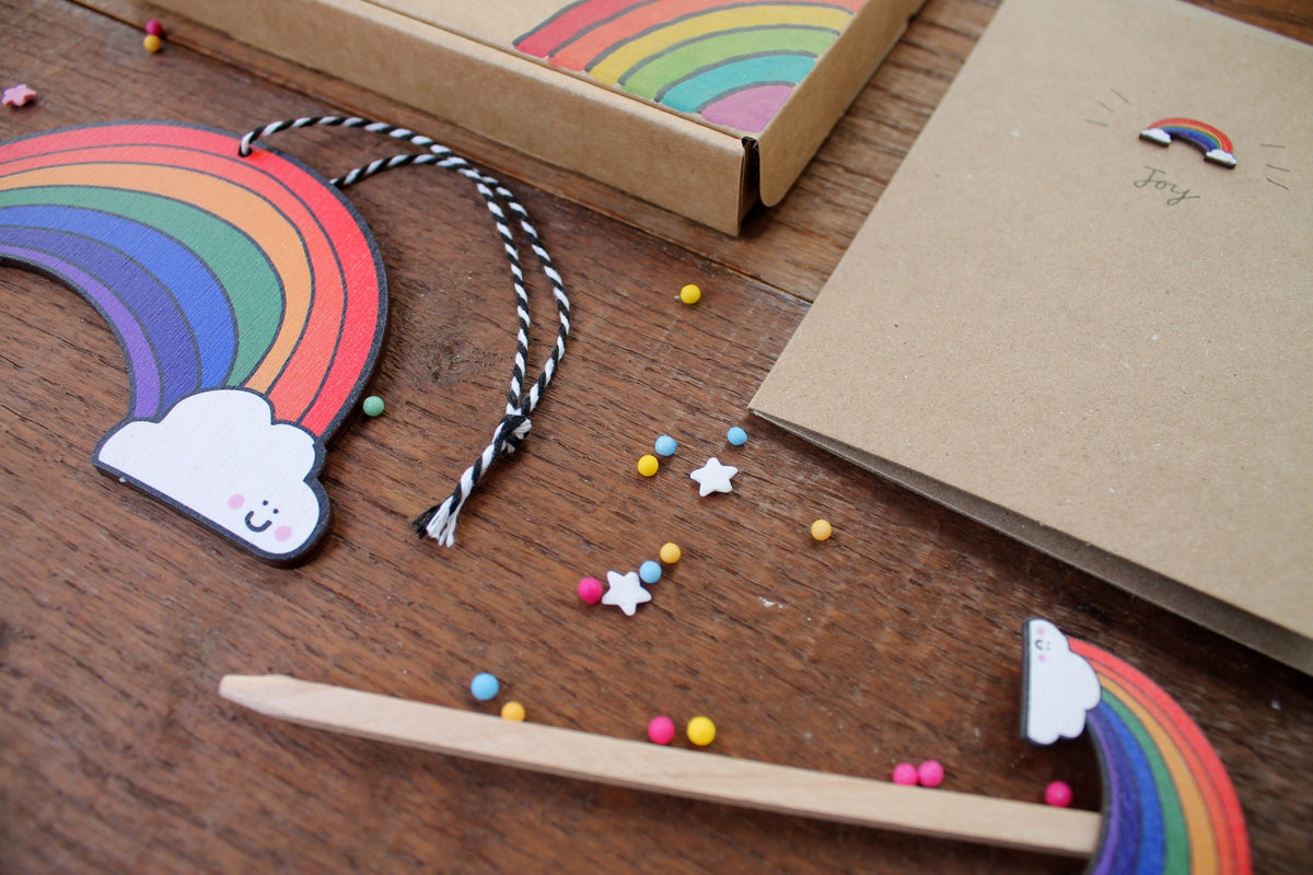 Laura Lee Designs rainbow box filled with birchwood rainbow card, plant stick and hanging rainbow by Cornwall based artist Laura Lee