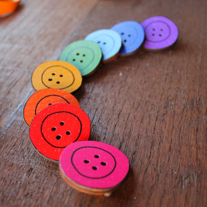 wooden button brooch in a rainbow of colours by Laura Lee Designs in Cornwall