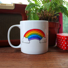 Load image into Gallery viewer, Rainbow mug with cute smiling clouds mental health funny mug Laura Lee Designs