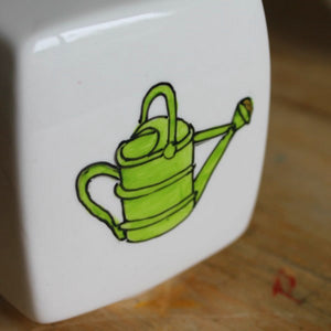 Hand painted watering can on china money box by Laura lee Designs in Cornwall
