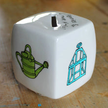 Load image into Gallery viewer, Watering can and victorian cloche hand painted on a cube money box by Laura Lee Designs