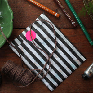 Note book gift wrap black and white stripe bag with colourful sticker