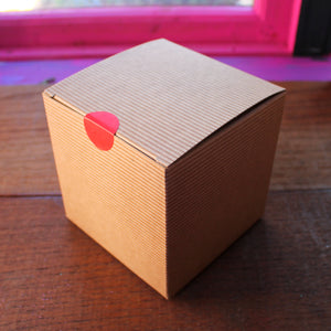 Brown kraft box with red sticker seal