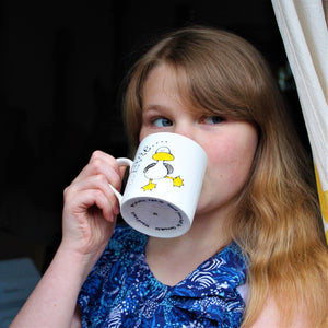 child just turned 12 drinking cocoa from a fun hand painted dancing duck mug by Laura Lee Designs