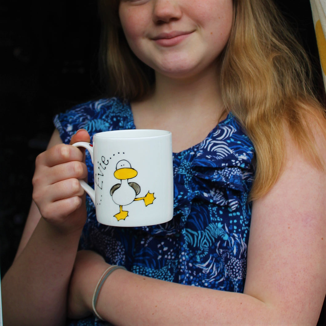 child drinking cocoa from a personalised dancing duck seagull mug