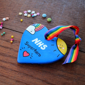 NHS superhero heart hand painted blue heart with a rainbow and a sun by Laura Lee Designs Cornwall