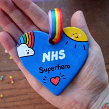 Load image into Gallery viewer, Hand painted ceramic NHS superhero heart rainbow blue heart