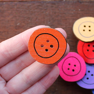 Orange button brooch by Laura Lee Designs in Cornwall