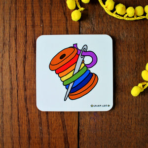 Rainbow bobbin coaster spool of colourful thread and sewing needle by Laura Lee designs Cornwall colourful homewares and gifts