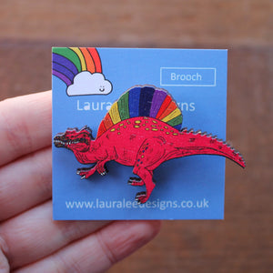 Punk spinosaurus rainbow dinosaur brooch on rainbow backing card by Laura Lee Designs Cornwall