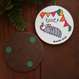 Cyril the woodlouse coaster by Laura Lee Designs Cornwall Entomology gift cute woodlouse blowing a party tooter pill bug in his party hat under colourful bunting