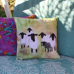 Bright watercolour sheep cushion by Laura Lee designs in Cornwall