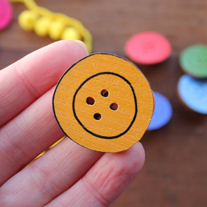 Yellow button brooch by Laura Lee Designs in Cornwall
