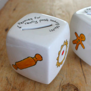 Rolling pin and bakewell cake hand painted on a china money box by Laura Lee Designs
