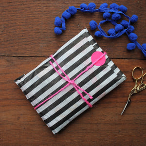 Black and white striped paper gift by gift wrapping by Laura Lee designs Cornwall