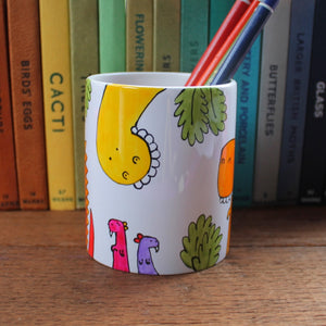Funny dinosaur pen pot by Laura Lee Designs hand painted in Cornwall
