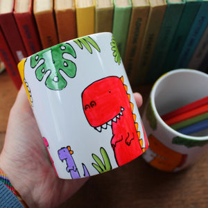 Dinosaurs and tropical plant pen pot by Laura Lee Designs in Cornwall