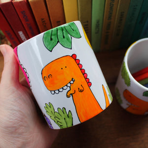 Orange dinosaur hand painted pot by Laura Lee Designs Cornwall