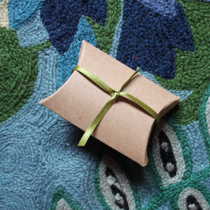 Kraft gift box with green ribbon