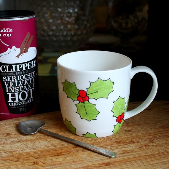 Hand painted holly mug by Laura Lee designs Cornwall