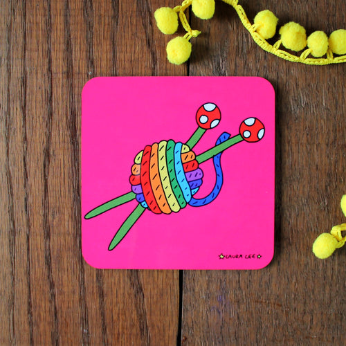 Rainbow yarn with knitting needles knitters coaster by Laura Lee designs colourful gifts and homewares for crafters
