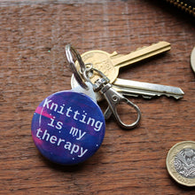 Load image into Gallery viewer, Knitting is my therapy galaxy keyring by Laura Lee Designs