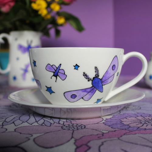 Moths and stars teacup and saucer hand painted by Laura lee designs