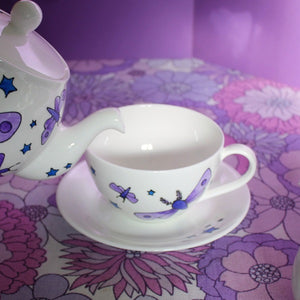 Moths and stars magical teacup by Laura lee designs