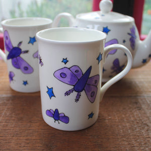 Moths and stars mug by Laura Lee Designs