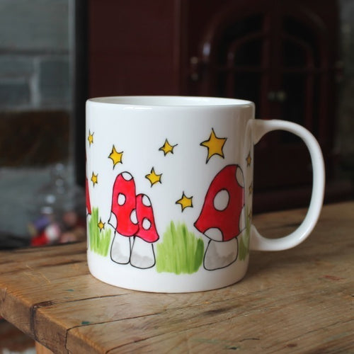 Hand painted mushroom mug. Hand painted fine china cup by Laura Lee in Cornwall