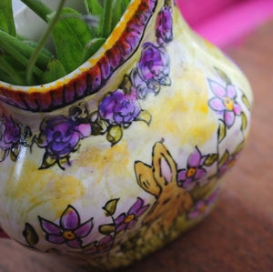 Close up of purple and pink roses on vintage bunny jug by Laura Lee Designs