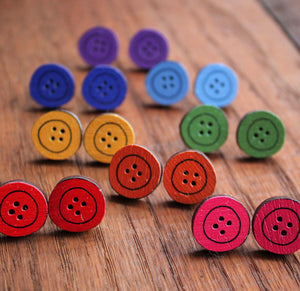 A rainbow of coloured wooden button studs by Laura Lee Designs
