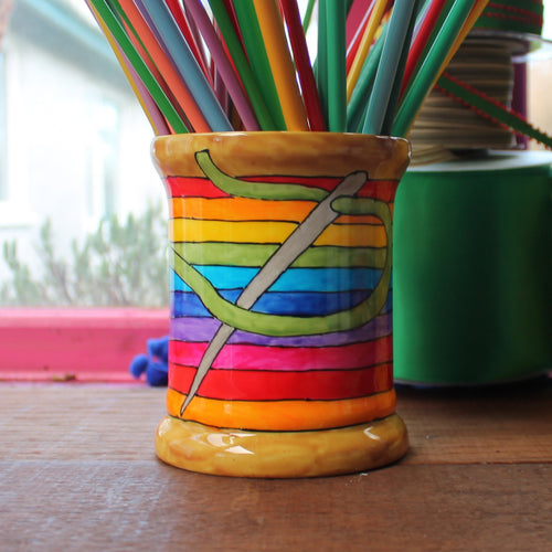 Rainbow sewing thread bobbin storage jar filled with knitting needles by Laura Lee Designs