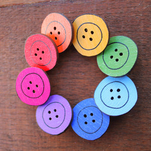 a rainbow of button brooches by Laura Lee Designs in Cornwall